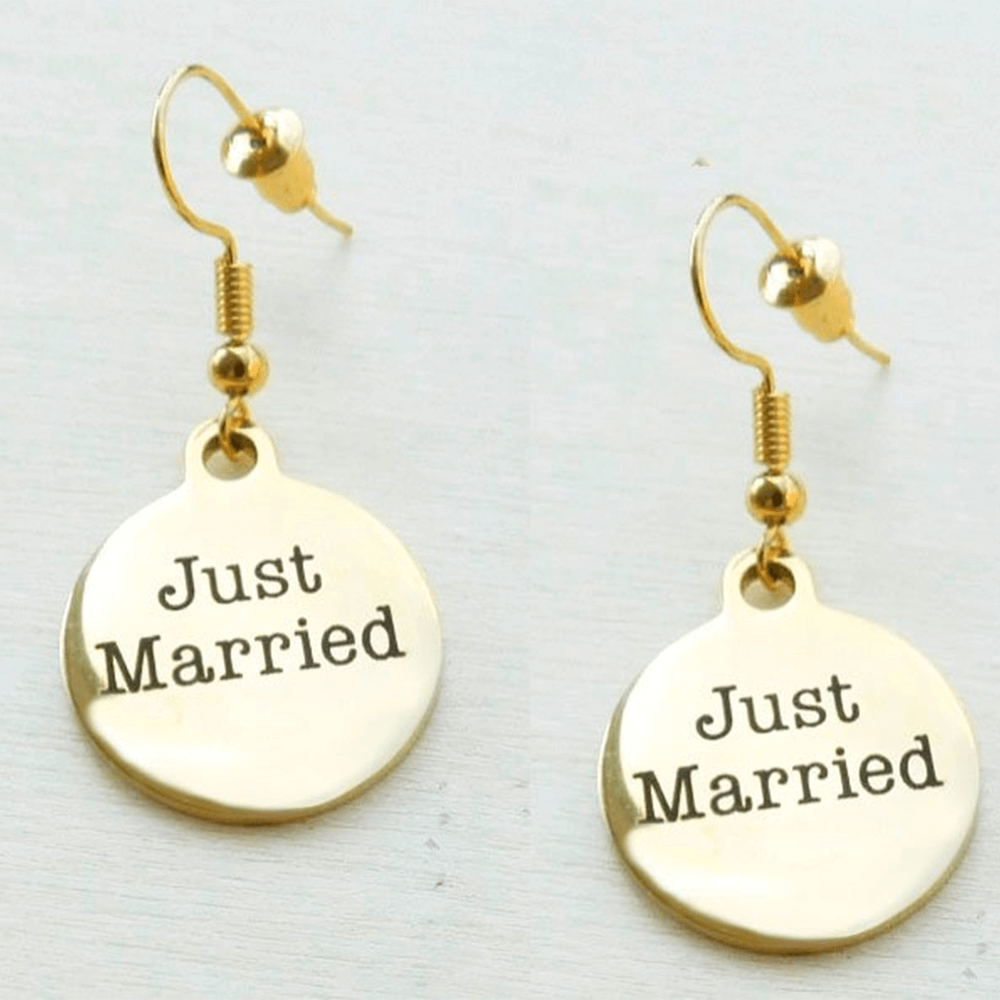 This is a pair of disc dangle earrings.
