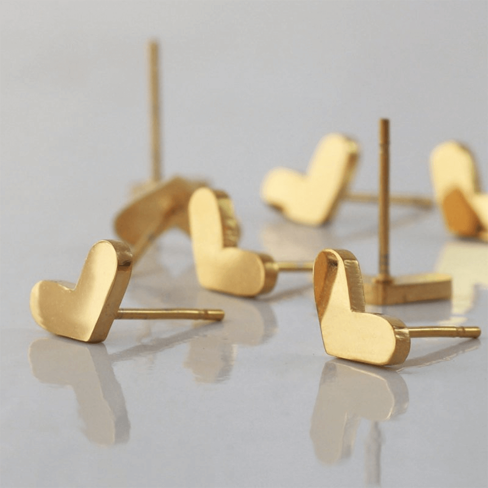 This is a pair of heart stud earrings.