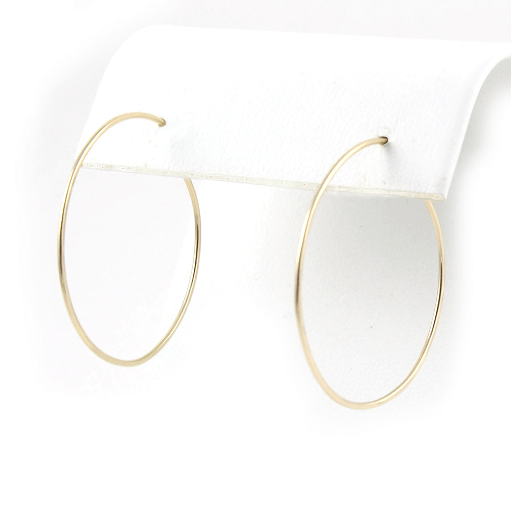 This is a pair of big hoop earrings.