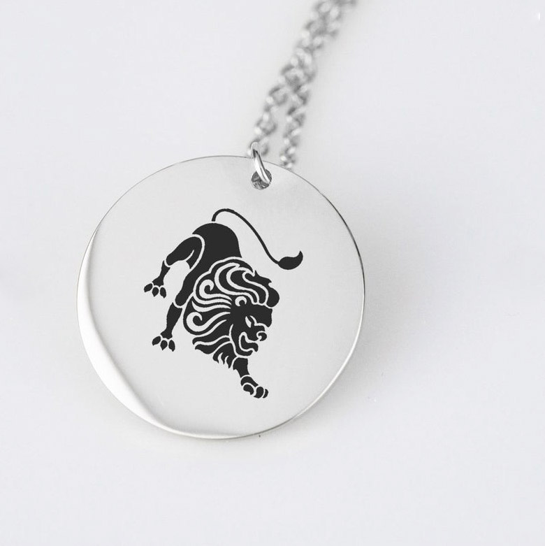 Engraved lion disc charm silver color necklace.