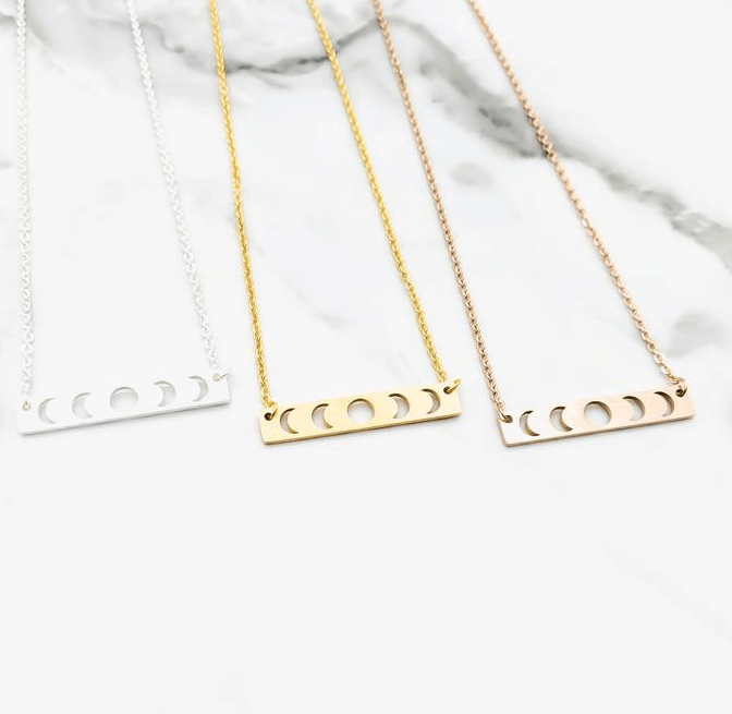 There are three moon bar necklaces.