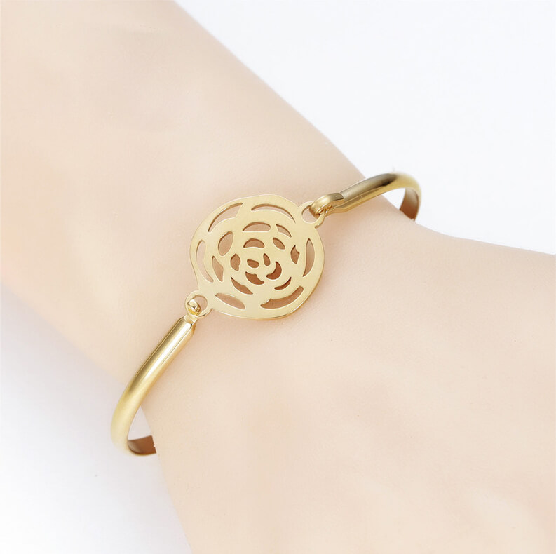 This is gold plated flower shape bangle.