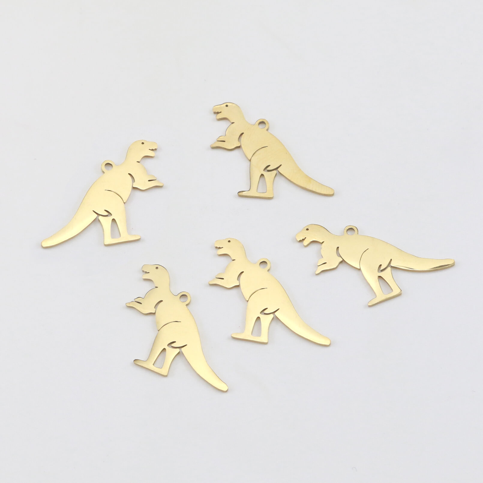 There are dinosaur pendants.