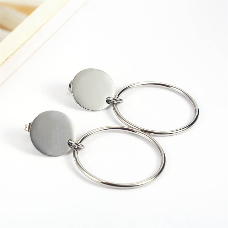 This a pait of silver round dangle earrings.