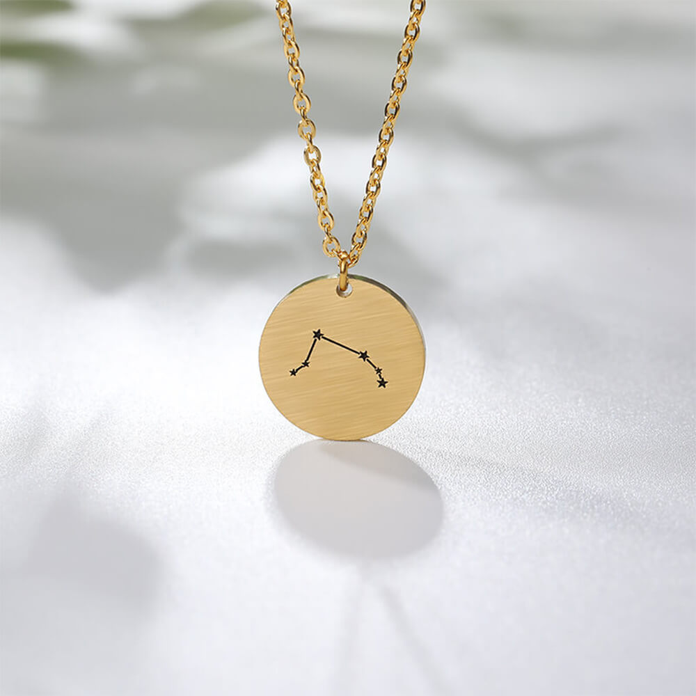 This is engraved disc  zodiac pendant necklace.