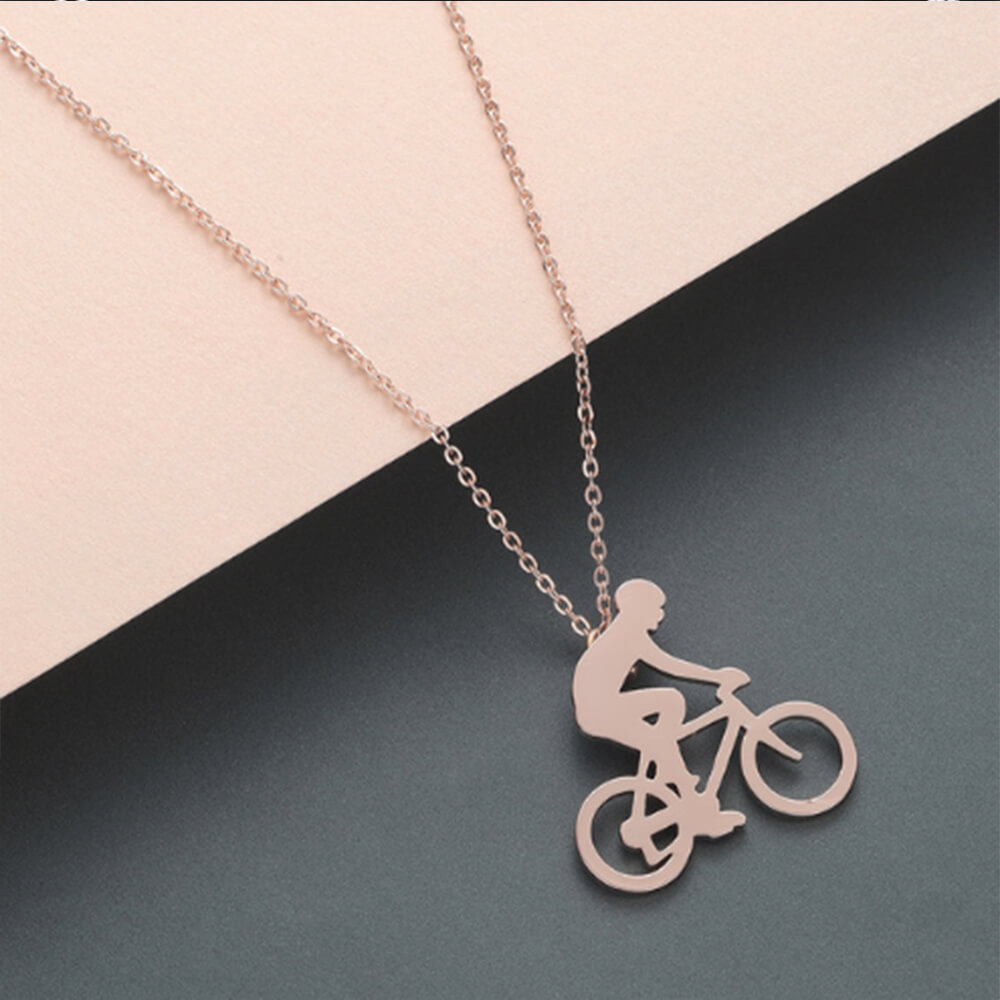 This is rose gold color pendant necklace.
